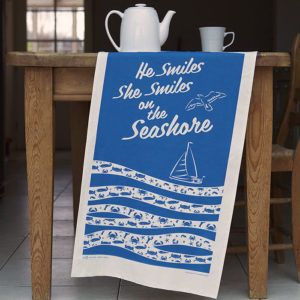 He Smiles Sea Side Tea Towel